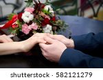 the lovers gently holding hands ...   Shutterstock . vector #582121279