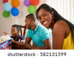 happy black family at home.... | Shutterstock . vector #582131599