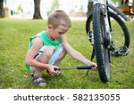 Young Boy Pumping The Bicycle...