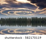 rows of pine trees with lake as ... | Shutterstock . vector #582170119