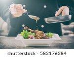 chef cooking restaurant food... | Shutterstock . vector #582176284