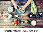 cooking food. woman cook breaks ... | Shutterstock . vector #582226141