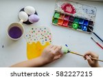 pens child painted eggs for