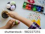 hands preparing eggs for easter | Shutterstock . vector #582227251