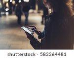 girl pointing finger on screen... | Shutterstock . vector #582264481