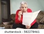 senior old woman shocked with... | Shutterstock . vector #582278461