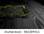 frame of rosemary on a black... | Shutterstock . vector #582289411