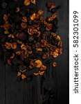 dried fruits on a black wooden... | Shutterstock . vector #582301099