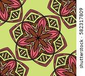 abstract flower seamless pattern   Shutterstock .eps vector #582317809