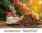 cup of coffee with smoke and... | Shutterstock . vector #582329227