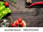 tomato and chilli  oil on dark... | Shutterstock . vector #582352345