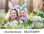 kids on easter egg hunt in... | Shutterstock . vector #582353899