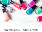 bottles of colored nail polish... | Shutterstock . vector #582357535