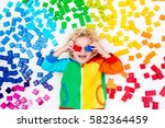 funny little boy playing with... | Shutterstock . vector #582364459