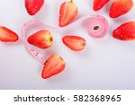 strawberry and tape isolated on ... | Shutterstock . vector #582368965