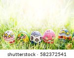 colorful egg on green grass... | Shutterstock . vector #582372541