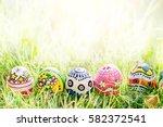 colorful egg on green grass... | Shutterstock . vector #582372541