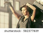 happy young woman with shopping ... | Shutterstock . vector #582377839