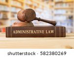 Small photo of administrative law books and a gavel on desk in the library. concept of legal education.