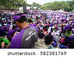 Small photo of Kuala Lumpur- February 18, 2017: H355 Muslim Unite written on a purple shirt of a participant of peace gathering to show support for Act 355 amendment.