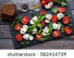 cherry tomatoes  mozzarella... | Shutterstock . vector #582414739