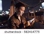 young handsome man connecting... | Shutterstock . vector #582414775