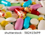 multicolored pills and tablets... | Shutterstock . vector #582415699