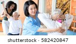 rehab clinic gym. elderly man... | Shutterstock . vector #582420847