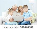 children and grandparents using ... | Shutterstock . vector #582440689