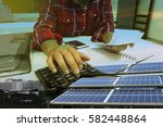 hand with calculator. solar... | Shutterstock . vector #582448864