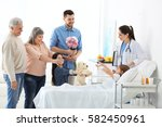 family visiting little girl in... | Shutterstock . vector #582450961