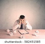 a young office worker sitting... | Shutterstock . vector #582451585