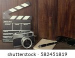 old camera with clapper movie... | Shutterstock . vector #582451819