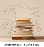 a pile of books on table with... | Shutterstock . vector #582455401