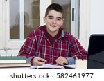 child at the school desk... | Shutterstock . vector #582461977