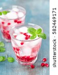 infused pomegranate water with... | Shutterstock . vector #582469171