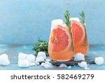 grapefruit and rosemary gin... | Shutterstock . vector #582469279