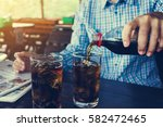 women hand pour or fill drink... | Shutterstock . vector #582472465