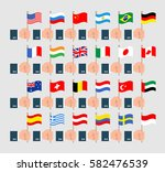human hand with flag set | Shutterstock .eps vector #582476539