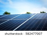 solar panels with blue sky   Shutterstock . vector #582477007