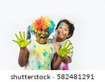 indian siblings playing colours ... | Shutterstock . vector #582481291