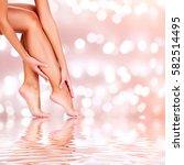 beautiful woman legs on an... | Shutterstock . vector #582514495