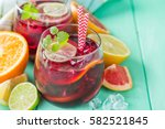 sangria and ingredients in... | Shutterstock . vector #582521845