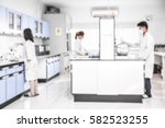 young laboratory assistant... | Shutterstock . vector #582523255