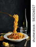 spaghetti on a fork. pasta with ... | Shutterstock . vector #582526027
