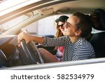 pretty young woman driving a... | Shutterstock . vector #582534979