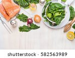 salmon with spinach cooking... | Shutterstock . vector #582563989