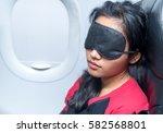 portrait of a woman sleeping in ... | Shutterstock . vector #582568801