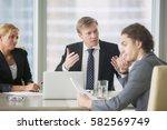 furious boss scolding young... | Shutterstock . vector #582569749