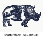 rhinoceros tattoo art. symbol... | Shutterstock .eps vector #582585031